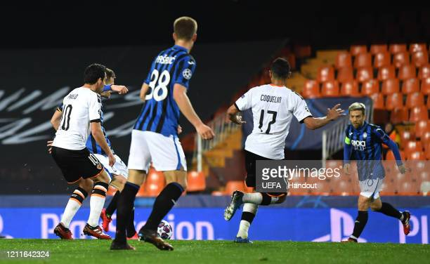 In this handout image provided by UEFA Josip Ilicic of Atalanta scores his sides third goal during the UEFA Champions League round of 16 second leg...