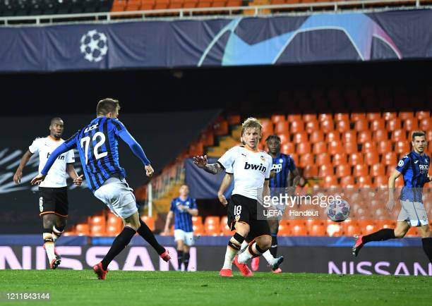 In this handout image provided by UEFA Josip Ilicic of Atalanta scores his sides fourth goal during the UEFA Champions League round of 16 second leg...