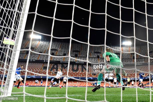 In this handout image provided by UEFA Josip Ilicic of Atalanta scores his sides fourth goal past Jasper Cillessen of Valencia during the UEFA...