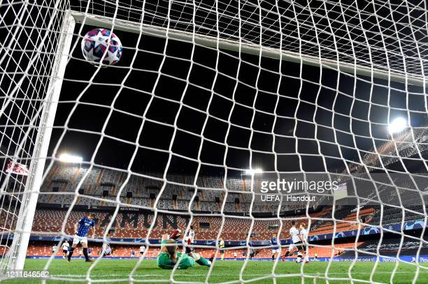 In this handout image provided by UEFA Josip Ilicic of Atalanta scores his sides third goal past Jasper Cillessen of Valencia during the UEFA...