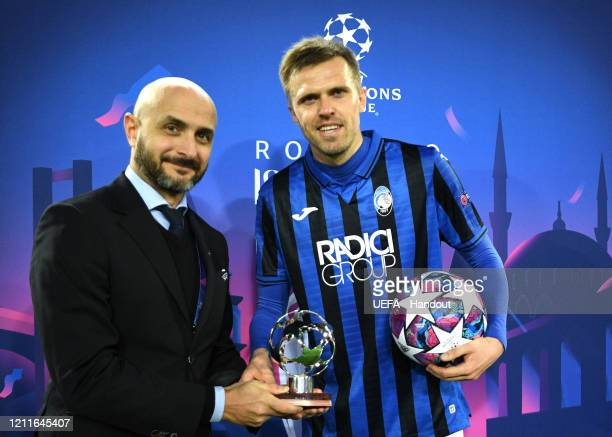 In this handout image provided by UEFA Josip Ilicic of Atalanta recieves the man of the match award and also the match ball after he scores all 4...