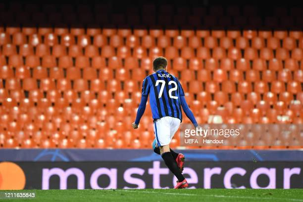 In this handout image provided by UEFA, Josip Ilicic of Atalanta celebrates to an empty stand after he scores his teams second goal from the penalty...