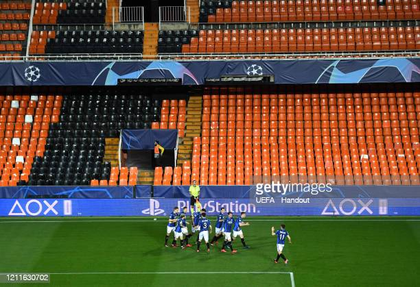 In this handout image provided by UEFA, Josip Ilicic of Atalanta celebrates with his team after he scores his teams first goal during the UEFA...