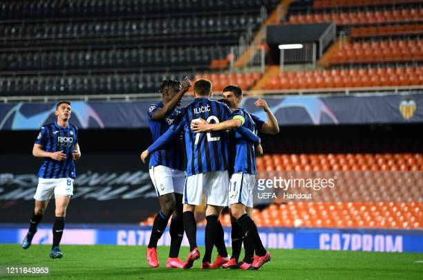 In this handout image provided by UEFA Josip Ilicic of Atalanta celebrates with his team after he scores his sides fourth goal during the UEFA...