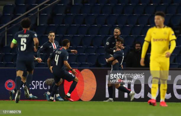 In this handout image provided by UEFA, Juan Bernat of Paris Saint-Germain celebrates with Neymar after scoring his team's second goal during the...