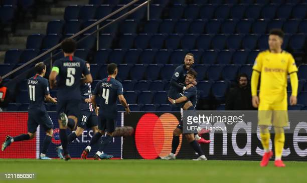 In this handout image provided by UEFA Juan Bernat of Paris SaintGermain celebrates with Neymar after scoring his team's second goal during the UEFA...