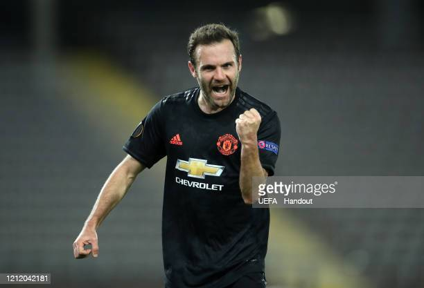 In this handout image provided by UEFA Juan Mata of Manchester United celebrates after scoring his team's third goal during the UEFA Europa League...