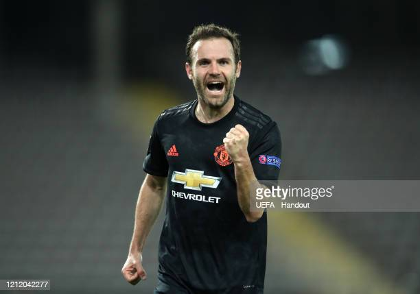 In this handout image provided by UEFA, Juan Mata of Manchester United celebrates after scoring his team's third goal during the UEFA Europa League...