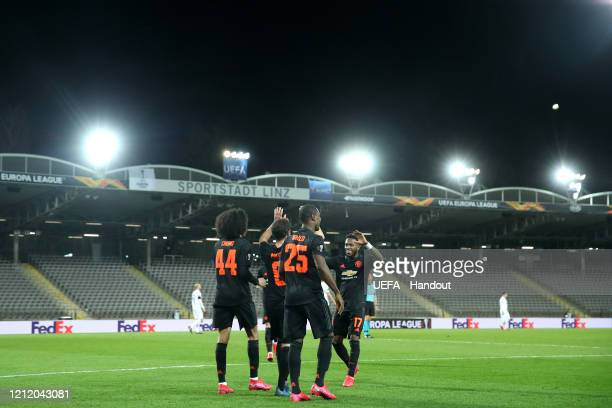In this handout image provided by UEFA Juan Mata of Manchester United celebrates with his team mates after scoring his team's third goal during the...
