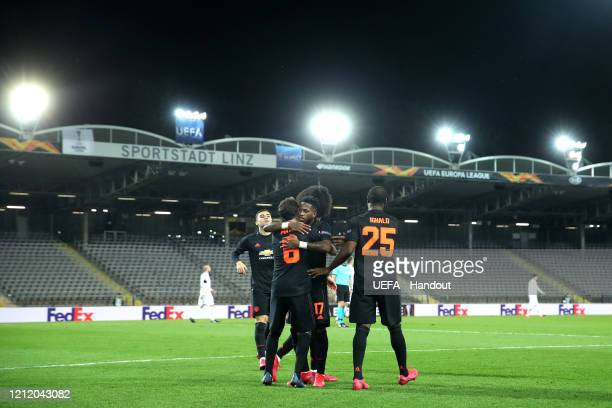 In this handout image provided by UEFA, Juan Mata of Manchester United celebrates with his team mates after scoring his team's third goal during the...