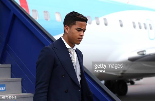 In this handout image provided by UEFA Justin Kluivert of Ajax arrives with team mates ahead of the UEFA Europa League Final between Ajax and...