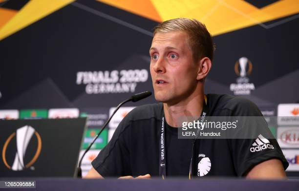 In this handout image provided by UEFA, Karl-Johan Johnsson of FC Kobenhavn speaks to the media during a press conference following the UEFA Europa...