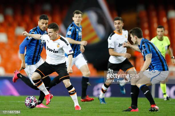 In this handout image provided by UEFA Kevin Gameiro of Valencia controls the ball during the UEFA Champions League round of 16 second leg match...