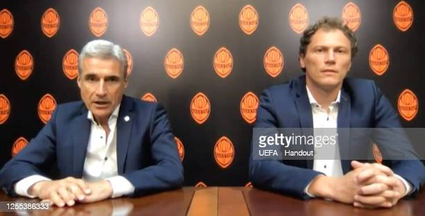 in this handout image provided by UEFA Luis Castro and Andriy Pyatov of FC Shakhtar Donetsk speak during the UEFA Europa League Draw at The UEFA...