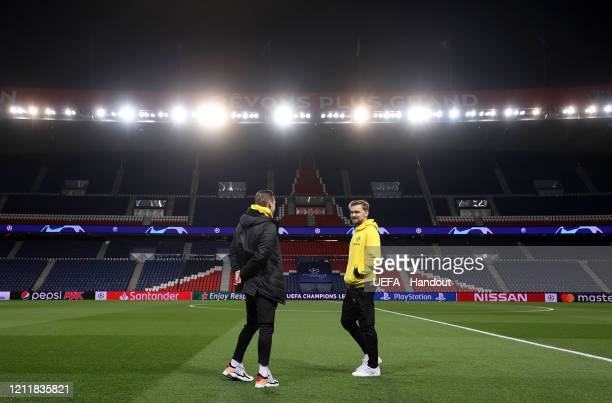 In this handout image provided by UEFA Lukasz Piszczek and Marcel Schmelzer of Borussia Dortmund take a look at the pitch prior to the UEFA Champions...