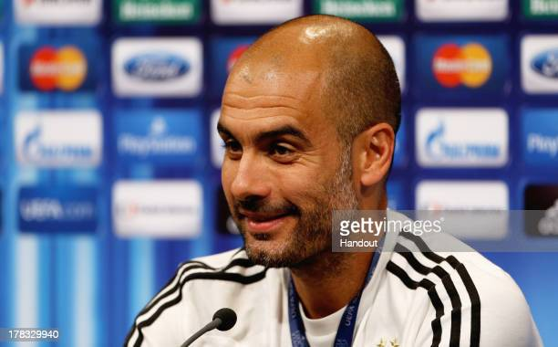 In this handout image provided by UEFA, Manager Josep Guardiola of Bayern Munich talks to the media prior to the UEFA Super Cup match between Bayern...