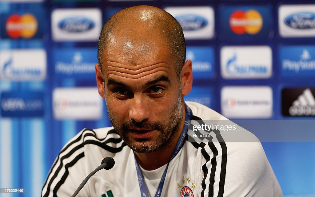 In this handout image provided by UEFA, Manager Josep Guardiola of Bayern Munich talks to the media prior to the UEFA Super Cup match between Bayern Muenchen and Chelsea FC at Stadion Eden on August 29, 2013 in Prague, Czech Republic.