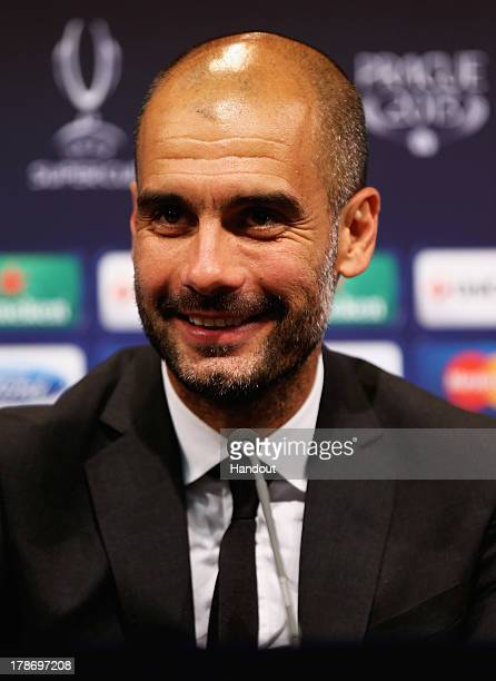 In this handout image provided by UEFA Manager Josep Guardiola of Bayern Munich talks to the media after the UEFA Super Cup match between Bayern...