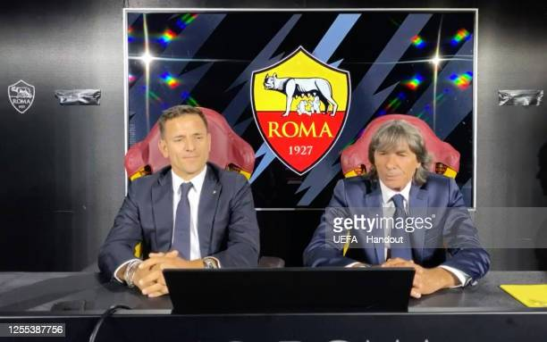 in this handout image provided by UEFA Manolo Zubiria and Gianluca Gombar of AS Roma react during the UEFA Europa League Draw at The UEFA...