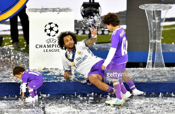 In this handout image provided by UEFA Marcelo of Real Madrid celebrates with children after the UEFA Champions League Final between Juventus and...