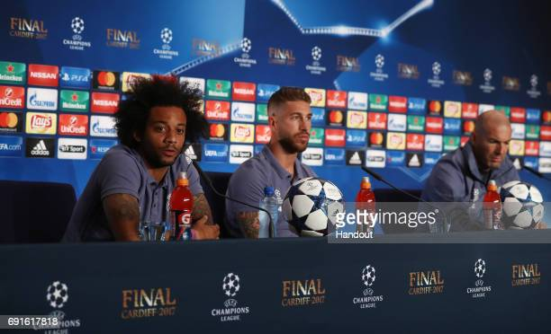 In this handout image provided by UEFA Marcelo Sergio Ramos and Zinedine Zidane coach of Real Madrid attend a press conference prior to the UEFA...