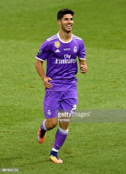 In this handout image provided by UEFA Marco Asensio of Real Madrid celebrates scoring his sides fourth goal during the UEFA Champions League Final...