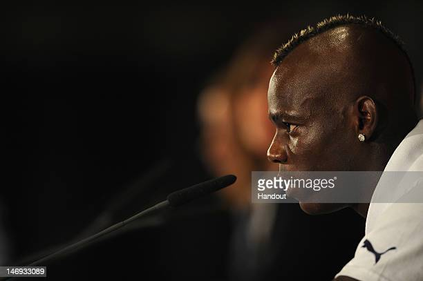In this handout image provided by UEFA Mario Balotelli of Italy talks to the media during a UEFA EURO 2012 press conference at the Olympic Stadium on...