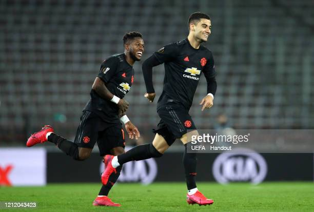 In this handout image provided by UEFA, Mason Greenwood of Manchester United celebrates with Fred after scoring his team's fourth goal during the...