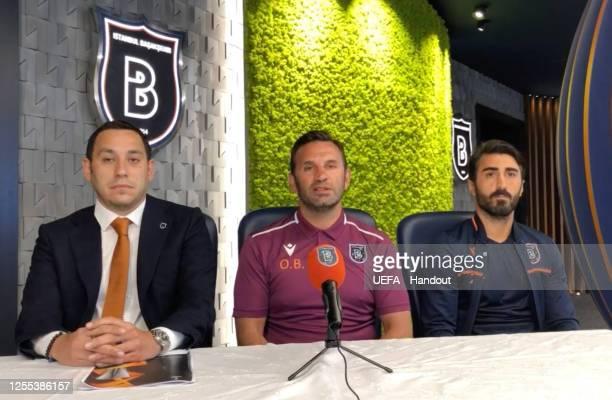 in this handout image provided by UEFA Mustafa Erogut Okan Buruk and Mahmut Tekdemir of Istanbul Basakehir speak during the UEFA Europa League Draw...