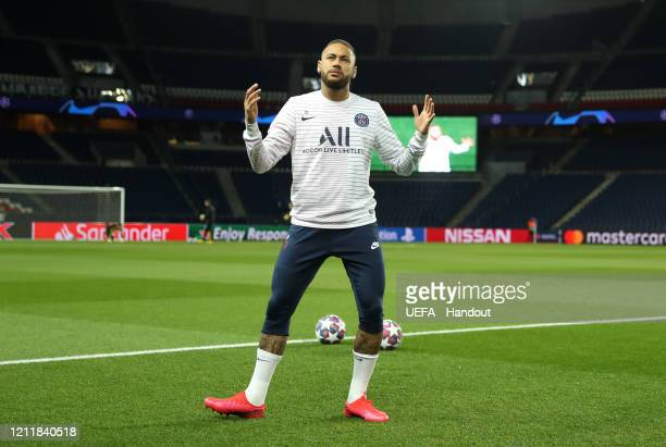 In this handout image provided by UEFA Neymar of Paris SaintGermain warms up prior to the UEFA Champions League round of 16 second leg match between...