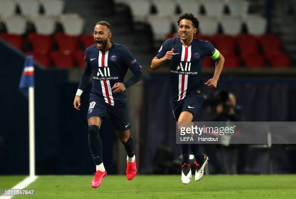 In this handout image provided by UEFA, Neymar of Paris Saint-Germain celebrates with Marquinhos after scoring his team's first goal during the UEFA...