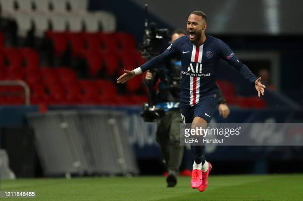 In this handout image provided by UEFA, Neymar of Paris Saint-Germain celebrates after scoring his team's first goal during the UEFA Champions League...