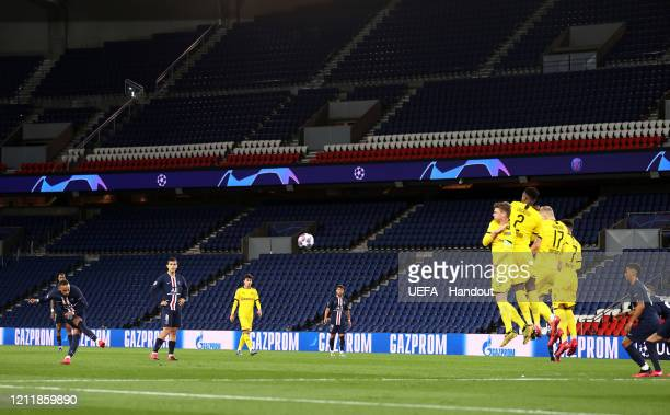 In this handout image provided by UEFA, Neymar of Paris Saint-Germain takes a freekick during the UEFA Champions League round of 16 second leg match...