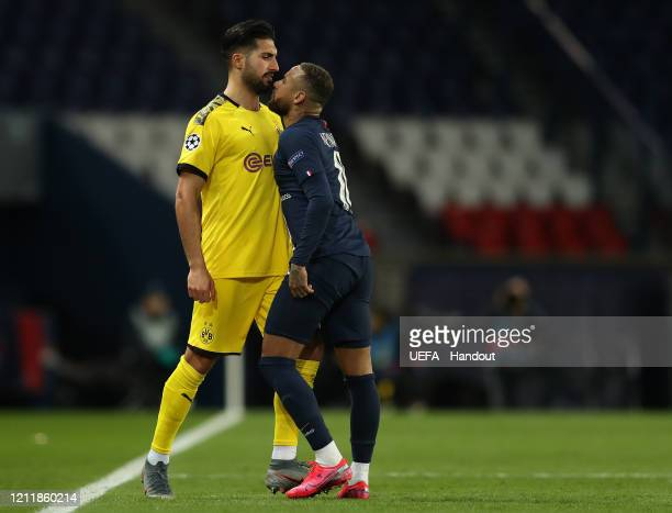 In this handout image provided by UEFA, Neymar of Paris Saint-Germain and Emre Can of Borussia Dortmund clash during the UEFA Champions League round...