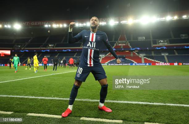 In this handout image provided by UEFA, Neymar of Paris Saint-Germain celebrates victory after the UEFA Champions League round of 16 second leg match...