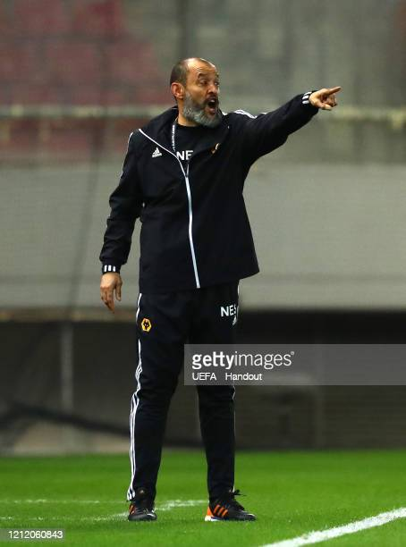 In this handout image provided by UEFA Nuno Espirito Santo Manager of Wolverhampton Wanderers gives his team instructions during the UEFA Europa...