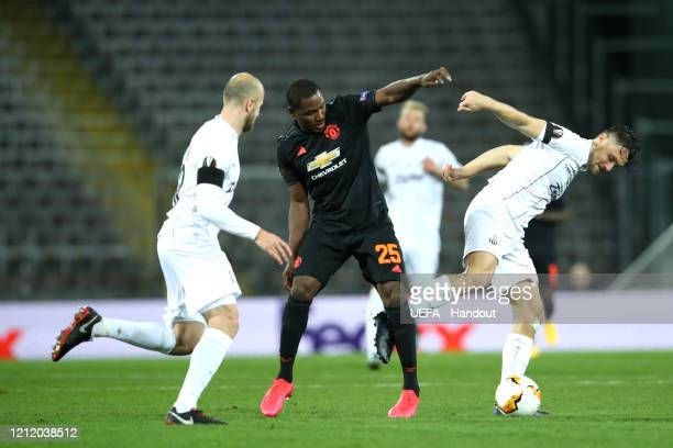In this handout image provided by UEFA Odion Ighalo of Manchester United is challenged by Gernot Trauner and James Holland of LASK during the UEFA...