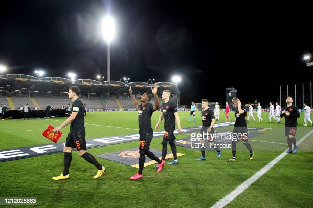 In this handout image provided by UEFA Odion Ighalo of Manchester United points to the sky as he walks out prior to the UEFA Europa League round of...