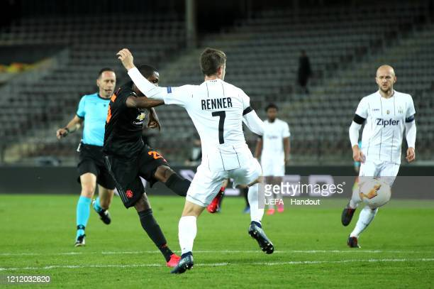 In this handout image provided by UEFA Odion Ighalo of Manchester United scores his team's first goal during the UEFA Europa League round of 16 first...