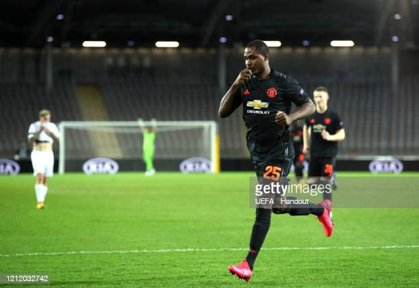 In this handout image provided by UEFA, Odion Ighalo of Manchester United celebrates after scoring his team's first goal during the UEFA Europa...