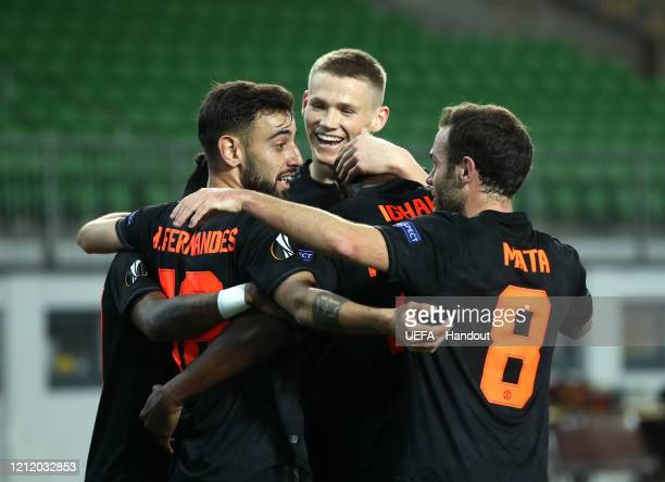 In this handout image provided by UEFA, Odion Ighalo of Manchester United celebrates with Fred, Bruno Fernandes, Brandon Williams and Juan Mata after...