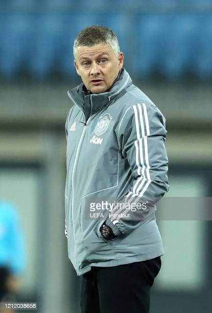 In this handout image provided by UEFA Ole Gunnar Solskjaer Manager of Manchester United looks on prior to the UEFA Europa League round of 16 first...