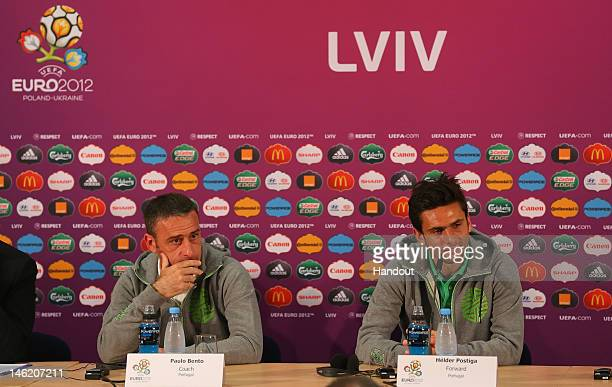 In this handout image provided by UEFA, Paulo Bento the coach of Portugal and Helder Postiga talk to the media during a UEFA EURO 2012 press...