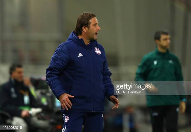 In this handout image provided by UEFA Pedro Martins Manager of Olympiacos FC reacts during the UEFA Europa League round of 16 first leg match...