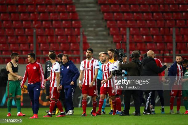In this handout image provided by UEFA Pedro Martins Manager of Olympiacos FC walks off after the UEFA Europa League round of 16 first leg match...