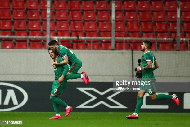 In this handout image provided by UEFA Pedro Neto of Wolverhampton Wanderers celebrates with Ruben Vinagre after scoring his team's first goal during...