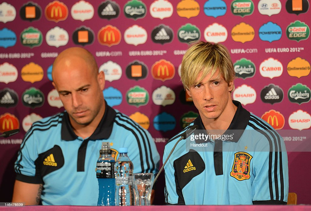 In this handout image provided by UEFA, Pepe Reina and Fernando Torres of Spain talk to the media during a UEFA EURO 2012 press conference at the Municipal Stadium on June 17, 2012 in Gdansk, Poland.