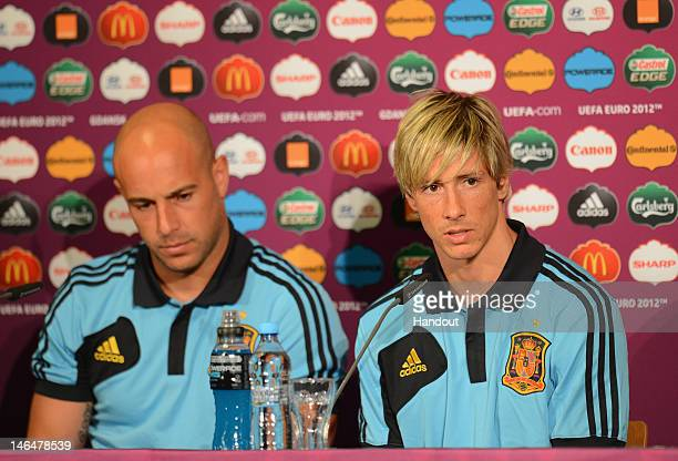 In this handout image provided by UEFA Pepe Reina and Fernando Torres of Spain talk to the media during a UEFA EURO 2012 press conference at the...
