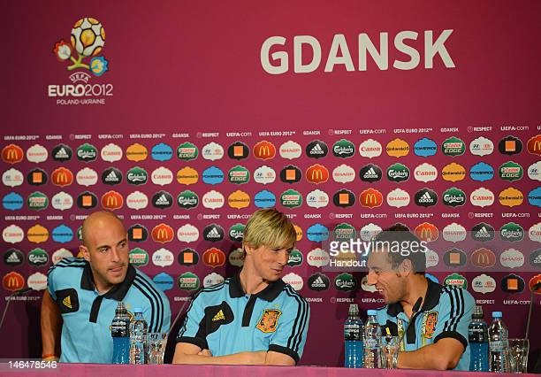 In this handout image provided by UEFA Pepe Reina Fernando Torres and Santi Cazorla of Spain talk to the media during a UEFA EURO 2012 press...