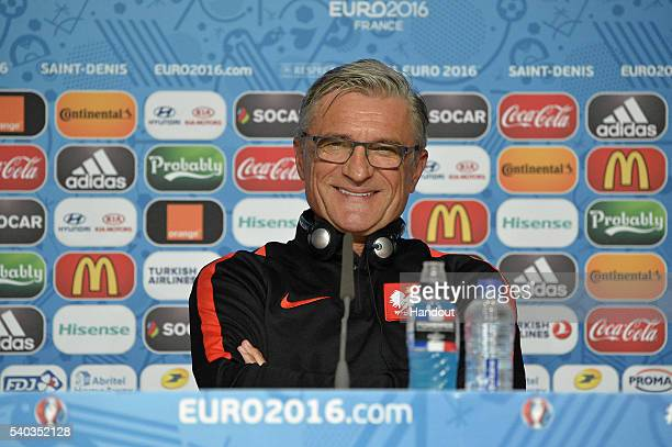 In this handout image provided by UEFA Poland Coach Adam Nawalka addresses the press during a Poland press conference on June 15 2016 in Paris France